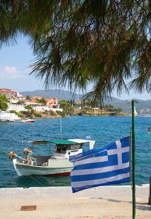 Greek flag on the beach in Neos Marmaras, Sitonia, Chalkidiki region, Greece Stock Photo