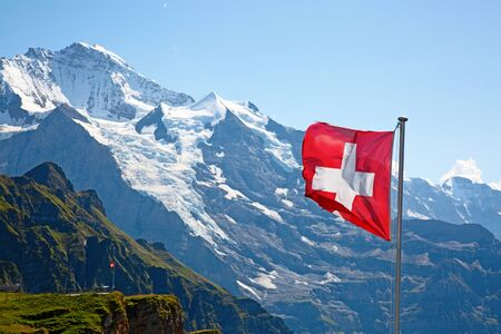 Swiss flag on the top of Mannlichen (Jungfrau region, Bern, Switzerland) Stock fotó