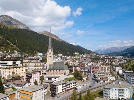 Aerial view of Davos city and lake. Davos is swiss city, famous location of annual meetings of World Economic Forum. 写真素材