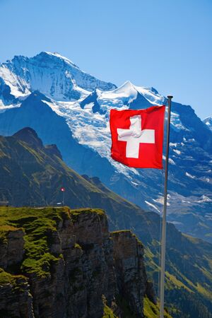 Swiss flag on the top of Mannlichen (Jungfrau region, Bern, Switzerland) 写真素材