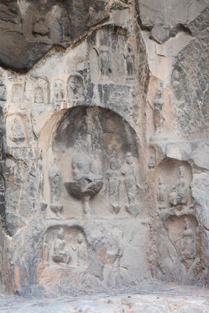 Famous Longmen Grottoes (statues of Buddha and Bodhisattvas carved in the monolith rock near Luoyang in Hennn province, China)