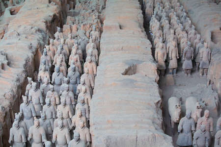 XIAN, CHINA - October 8, 2017: Famous Terracotta Army in Xi'an, China. The mausoleum of Qin Shi Huang, the first Emperor of China contains collection of terracotta sculptures of armored men and horses.
