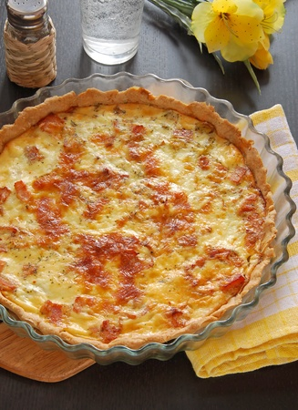 leeks: French pie Quiche Lorraine on the table with flower Stock Photo