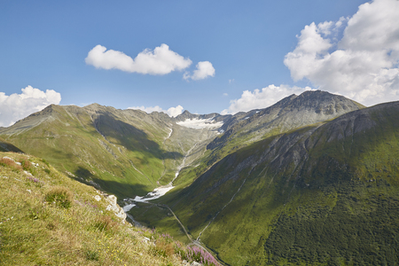 Furkapass Switzerland, sunny summer day in mountains