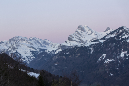 Sunrise over Swiss Alps with snow and glow. Glarus