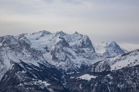 Hasliberg Mountains in winter with snow Stock Photo - 143014387