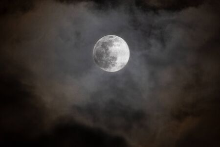 Super Moon with Clouds in Switzerland Stock Photo - 142063818