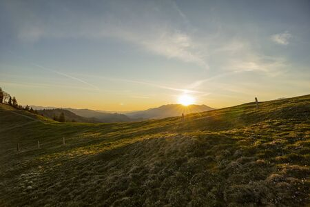 Sunrise over Emmental with crocus flowers Stock Photo - 146508322