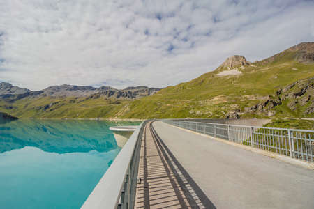 Turquoise Lac Moiry lake with dam in Valais mountains in Switzerland
