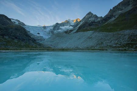 Sunrice at Glacier Lake Lac Chateaupre with Mory Glacier in Valais Switzerland