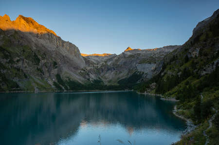 Sunrise and morning at Lake Tseuzier with barrage in Valais Switzerland in September.