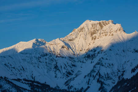 Sunrise in Adelboden region Elsigen Bernese Oberland in winter Standard-Bild