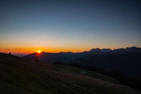 Sunrise over Friborg alps in Switzerland. Sunny blue sky.