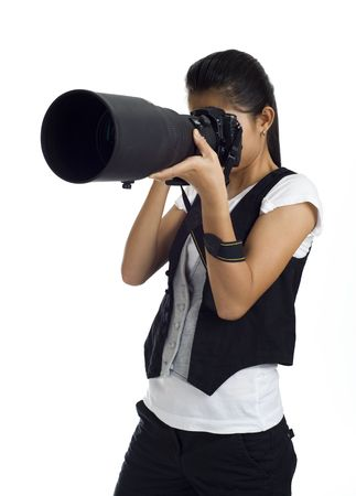 asian girl holding a dslr cam with an 300mm tele lens attached Stock Photo - 3665033