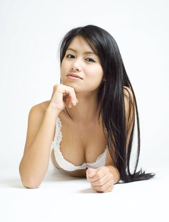 young asian woman posing in white lingerie Stock Photo - 3688153