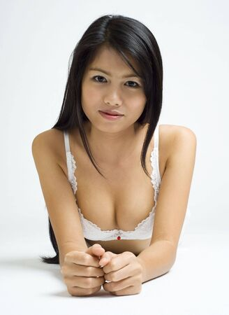 young asian woman posing in white lingerie Stock Photo - 3688152