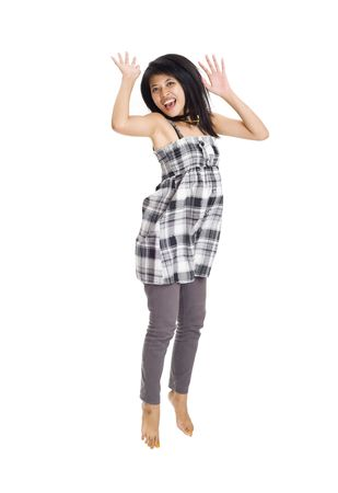 young asian girl isolated on white background is jumping for joy photo