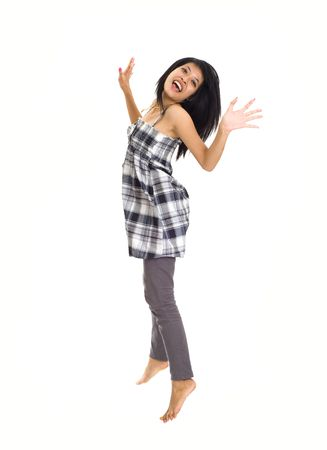 young asian girl isolated on white background is jumping for joy Stock Photo - 3829134