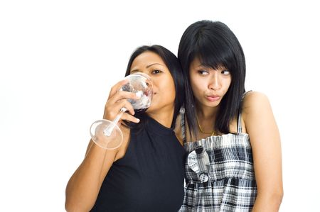 two young asian women isolated on white background making funny faces photo