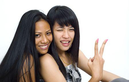 two young asian women making fun Stock Photo - 3829145