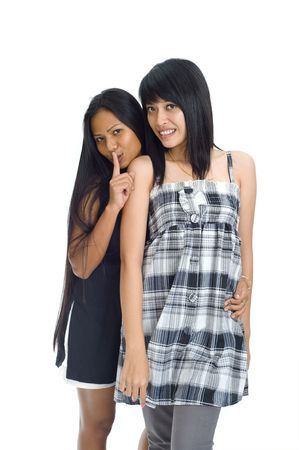 Two young asian women reminding to keep something secret photo