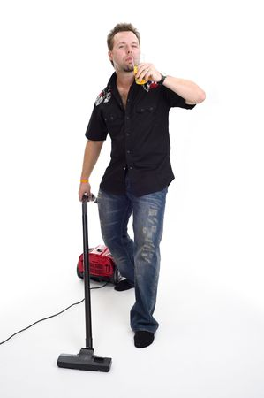 Macho with vacuum cleaner and beer photo