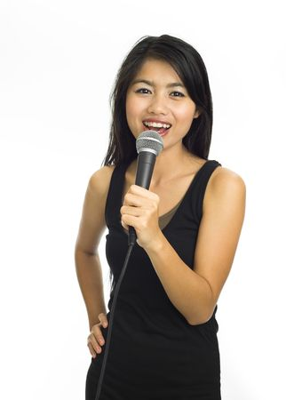 Young asian singing with microphone photo