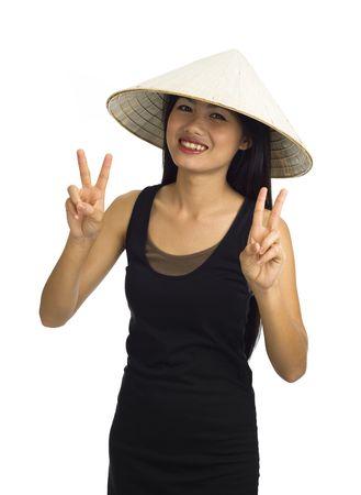 beautiful young asian woman making peace signs photo