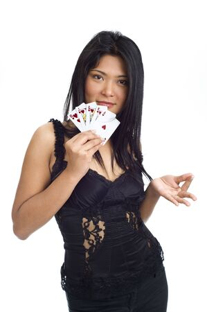 high stakes: asian girl showing a royal flush