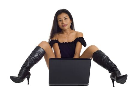 asian woman with sexy outfit working on her notebook photo