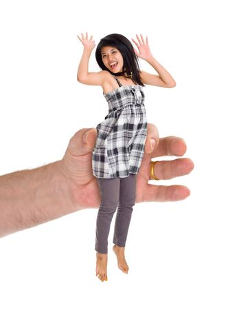 a huge hand holding a small asian woman Stock Photo