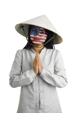 young attractive asian woman with us flag painted on her face and typical welcome expression photo