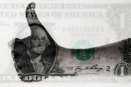 stock predictions: pollice digitalmente con il corpo dipinto un dollaro fattura Archivio Fotografico