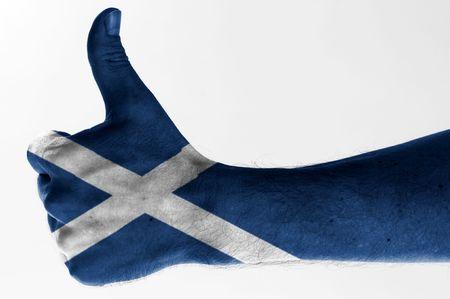 scottish flag: thumb up with digitally body-painted scottish flag