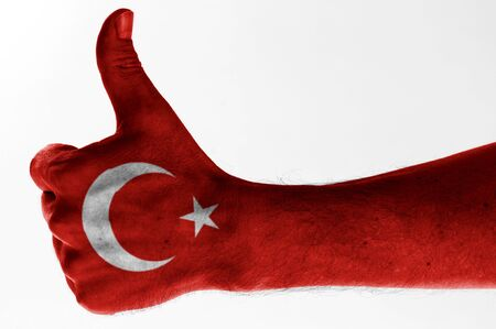 thumb up with digitally body-painted turkish flag  Stock Photo