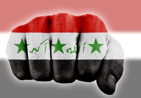 fist with iraqi flag  photo
