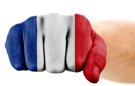 fist with french flag isolated on white photo