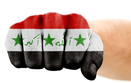 fist with iraqi flag isolated on white photo