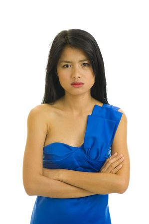 beautiful young asian woman with nice blue dress doesnt seem to be very happy - isolated on white