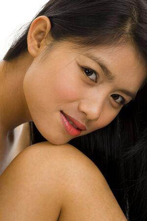 young asian woman posing nude