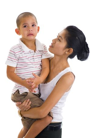 asian woman holding a cute crying boy photo
