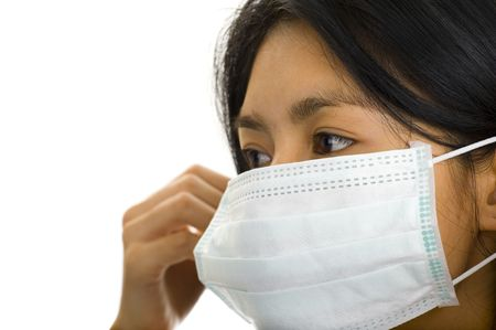 asian woman putting on a face mask