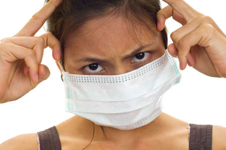 protective face mask on an attractive young asian woman, isolated on white Stock Photo - 4798434