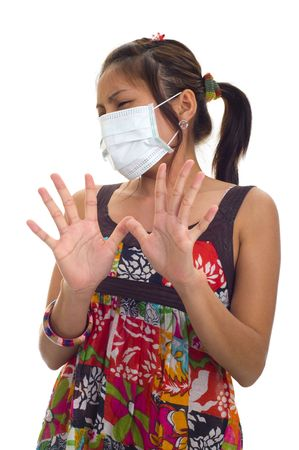 protective mask on young asian woman, isolated on white photo