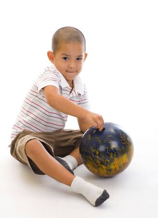 cute boy with bowling ball