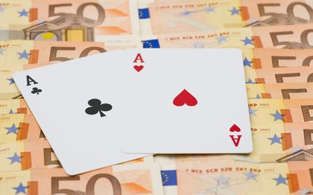2 50: 2 aces on lots of 50 euro bills. focus on the middle symbol of the cards.