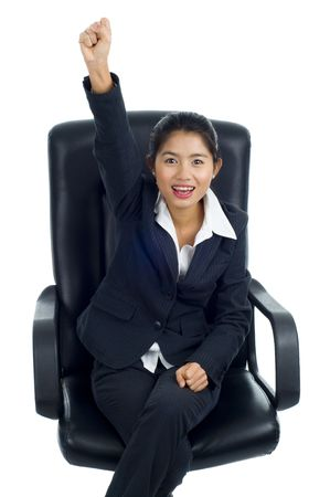 beautiful young asian business woman is happy because she was successful. isolated on white. photo