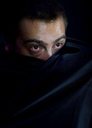 creepy caucasian man hiding behind black silk Stock Photo - 5175461