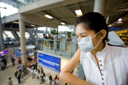 woman with protective mask at the international airport in bangkok