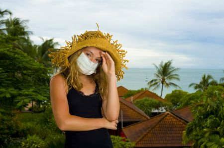 caucasian teenager wearing a face mask. concept picture: swine flu on holidays Stock Photo - 5312784